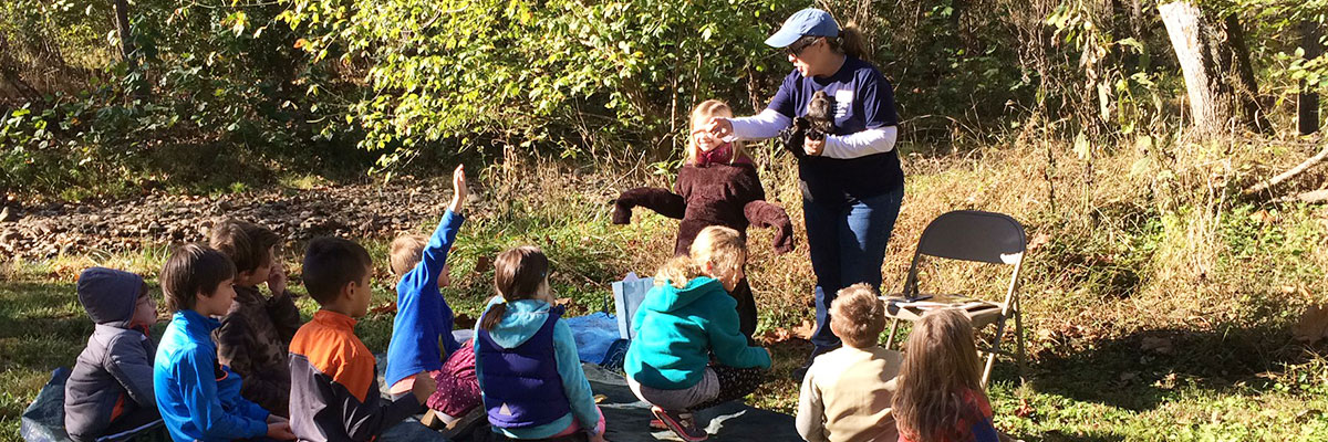Young students attending an outdoor Claytor Nature Center event.