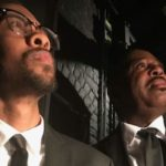 Desmond Mosby and James Stewart portraying Malcolm X and Martin Luther King Jr.