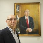 Faculty member honored with portrait at local high school