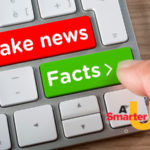 """A keyboard with a red button that says """"fake news"""" and a green button that says """"facts"""""""