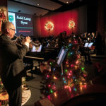 A man plays a trumpet during a holiday concert