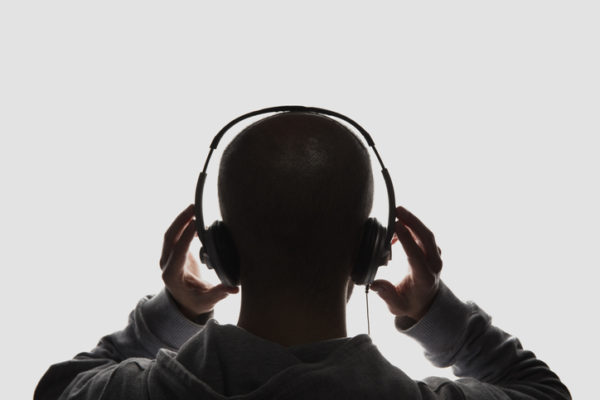 Male silhouette with headphones