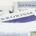 The word Terrorism appears as a newspaper headline