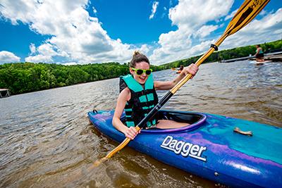 Student kayaking on Leesville Lake