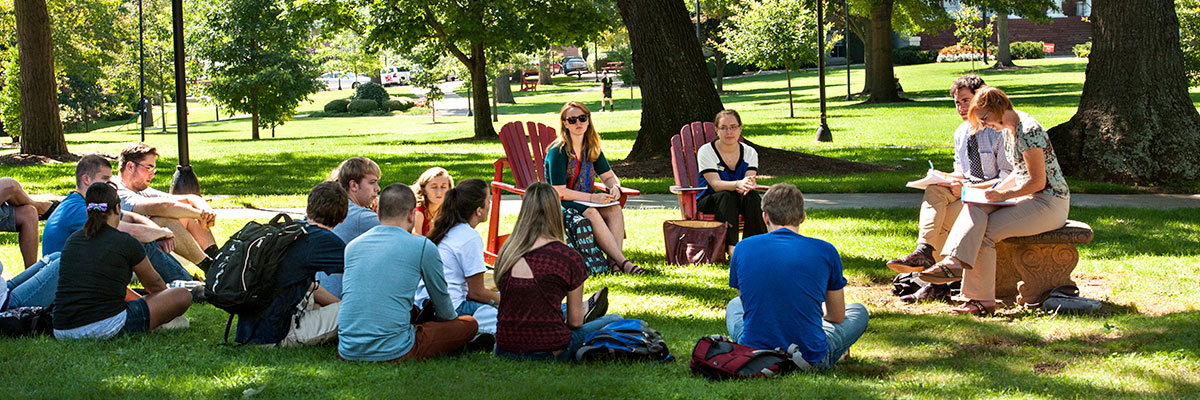 An outdoor class in the Dell taught by history professors Adam Dean and Lindsay Michie