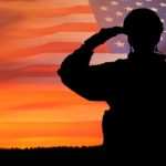 soldier and flag with sunset