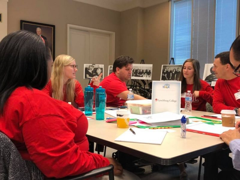 Lynchburg College students work together around a table.