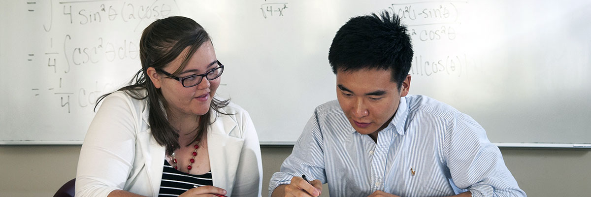 A tutor helping a student with a math problem