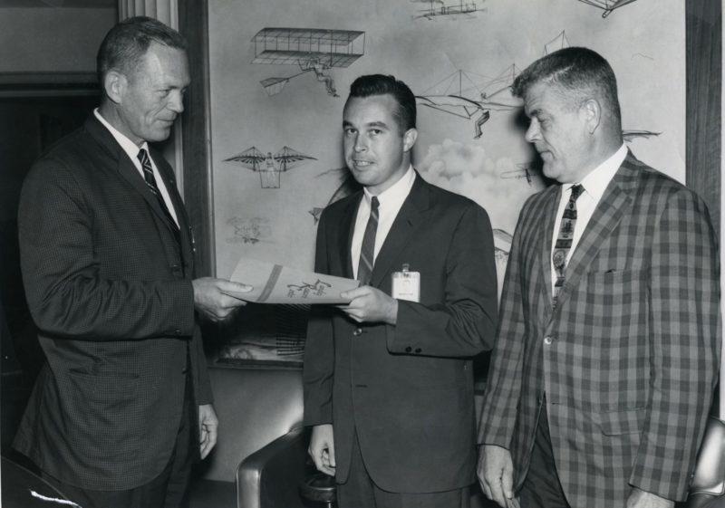 1963 photo of Ken Garren receiving a cash award