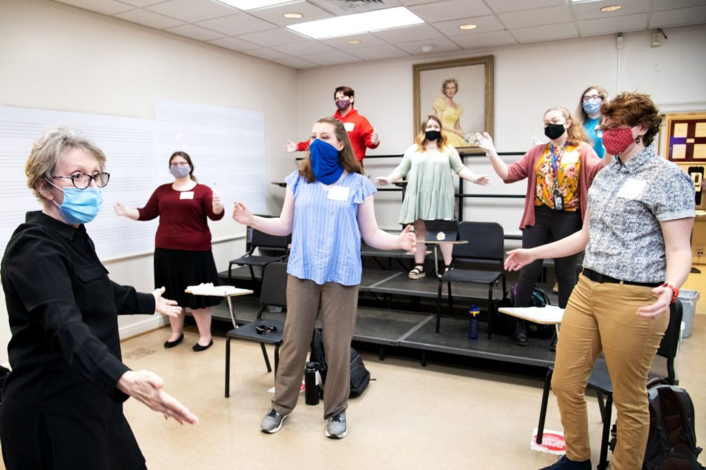 Carol Krueger leads a group of music education students in an exercise