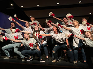 "Curtain Call musical theatre participants singing in ""Heart Damn Yankees"""