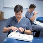 PA student practicing suturing in advanced clinical practice course
