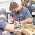 PA students practicing suturing during advanced clinical practice course