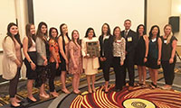 Second year PA student Sunny Pydah with other conference attendees holding award for top student