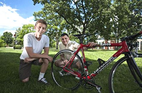 Chad Hobson with Dr. Eric Goff and a bicycle
