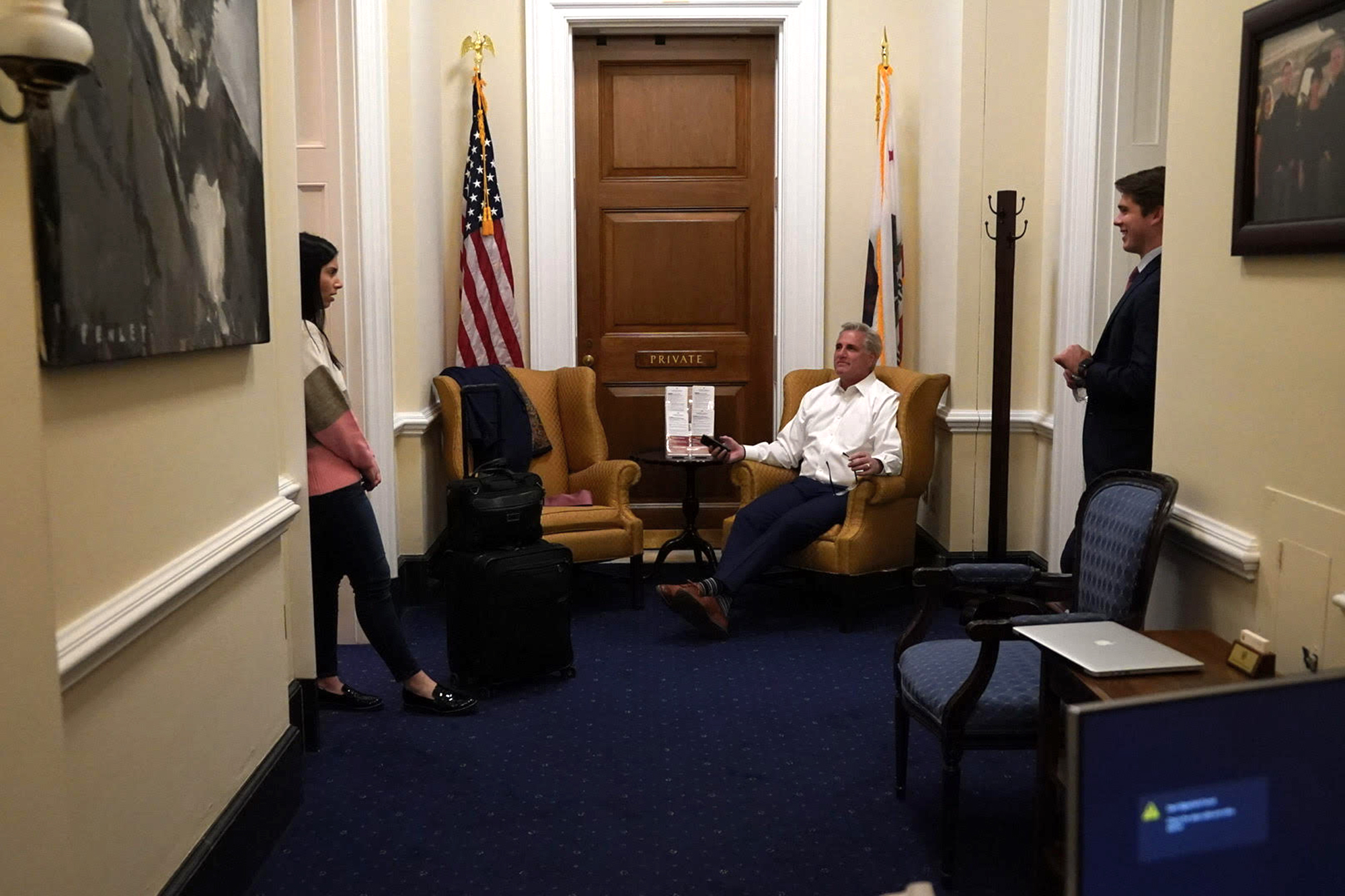 Stephen Ruppel, Representative Kevin McCarthy, and another staff member stand in a hallway