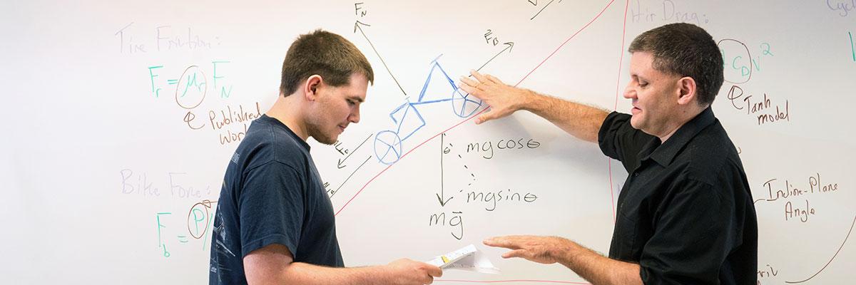 Physics major Carl Pilat '21 with physics professor Eric Goff