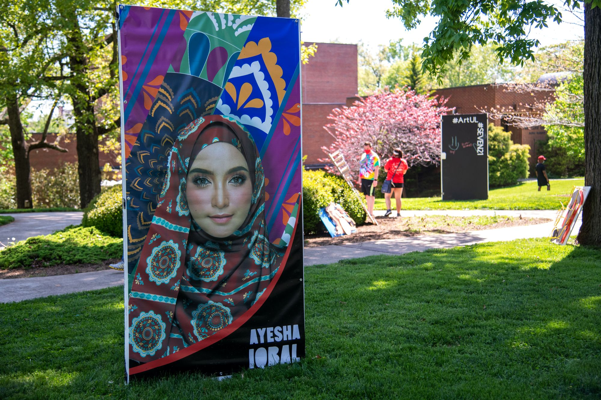 Fabric patterns created by Ayesha Iqbal displayed on a large stand outside