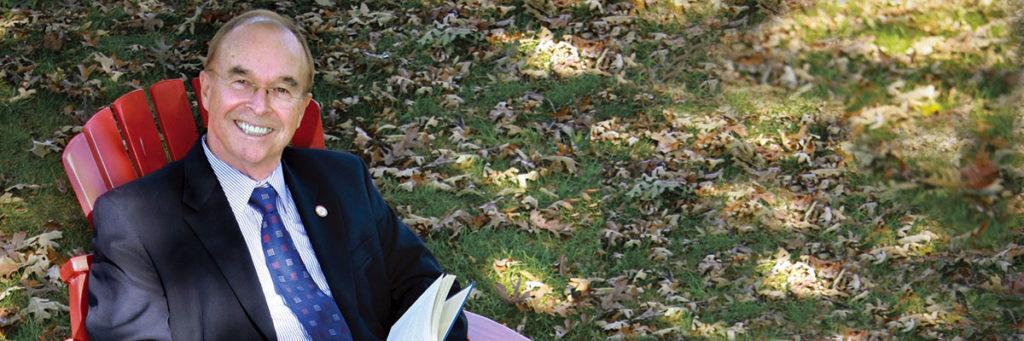 President Garren sitting in a chair outside