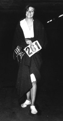 Kathrine Switzer holds her race numbers 261 after finishing the Boston Marathon. Her feet are wrapped in bandages.