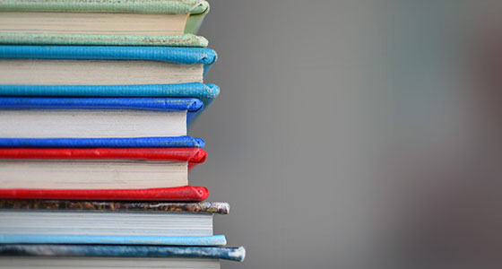 Stack of different colored books