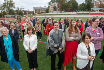 People gathered on Shellenberger Field during the dedication