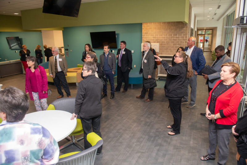 A group tours the new residence hall