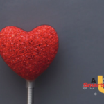 a heart on a stick with the logo for A Smarter U in the background