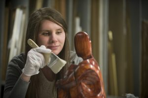 Sarah Turner, westover honors graduate, paints a sculpture.