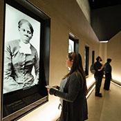 Westover student in front of portrait of Harriet Tubman